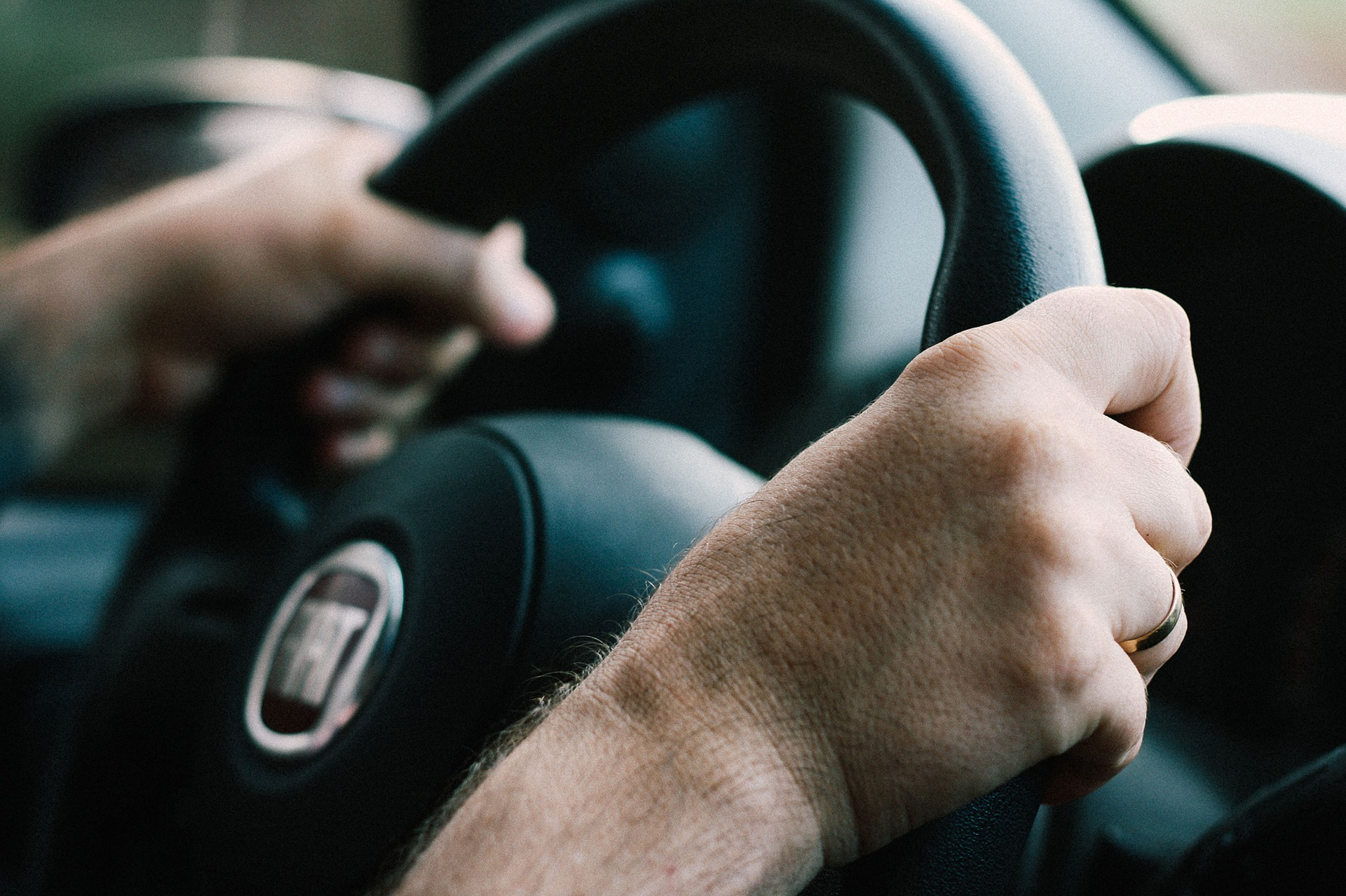 hands on steering wheel for blog about preventing drowsy driving