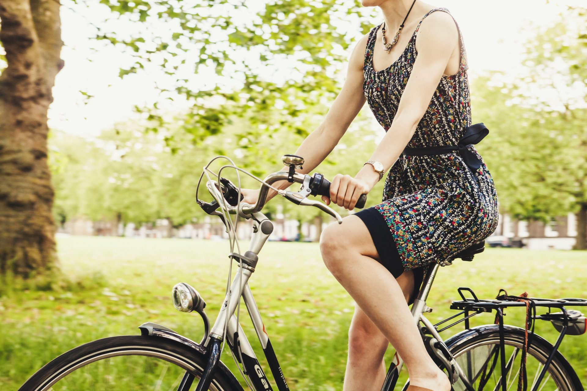 woman on bicycle to illustrate blog about springtime accidents